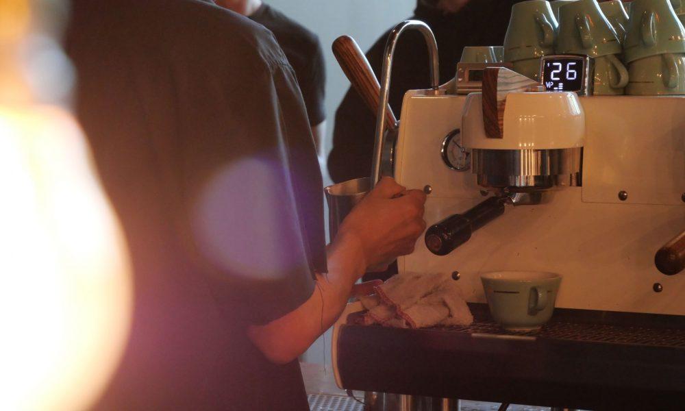 A barista showing how to make espresso