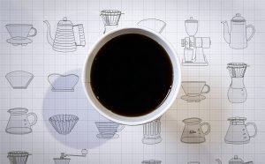 cup of coffee atop a mat with icons of coffee brew methods