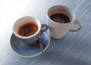 a long black and an americano side by side