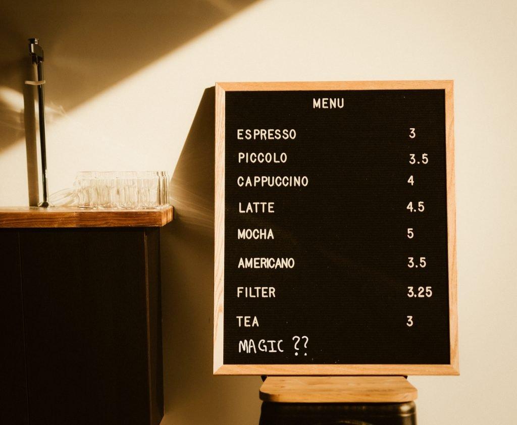 a cafe menu with magic coffee