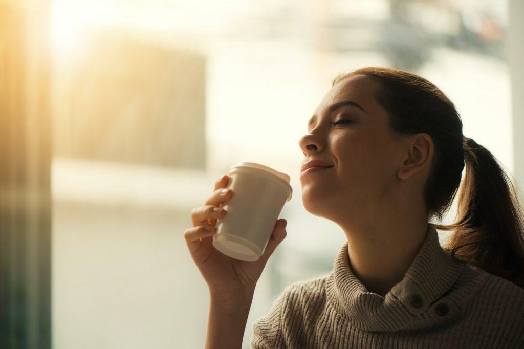 a lady enjoying her coffee
