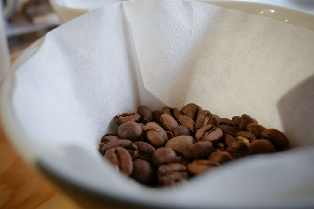 roasted coffee beans in a paper filter