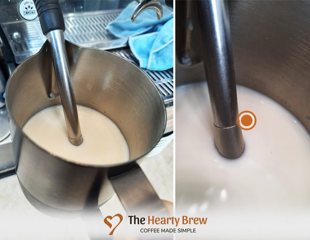 ideal depth of the steam wand tip for steaming milk