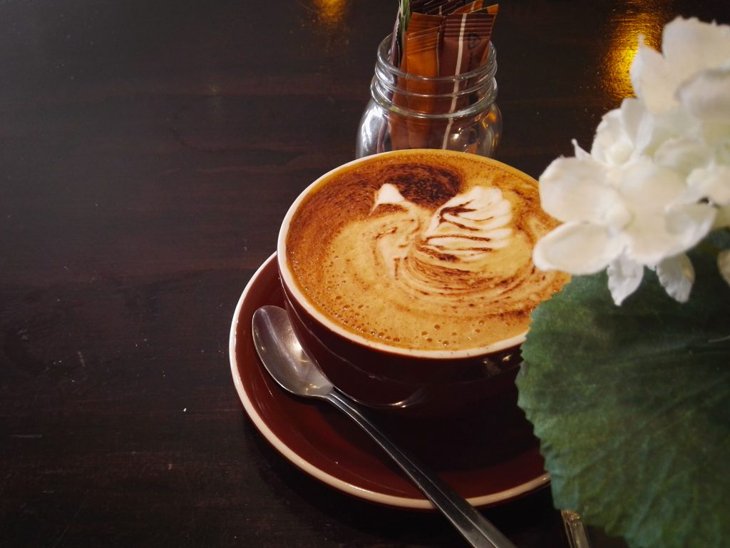 mocha coffee beside a plant