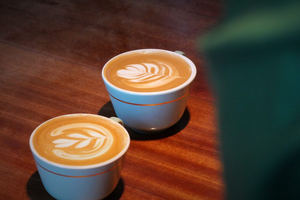 two cups of flat whites